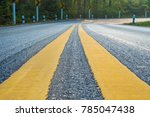 yellow sign on small and curve... | Shutterstock . vector #785047438