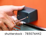 man mounting the plastic handle ...   Shutterstock . vector #785076442