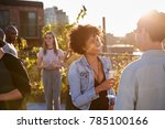 friends talking at a rooftop... | Shutterstock . vector #785100166