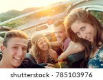 group of happy people in a car... | Shutterstock . vector #785103976