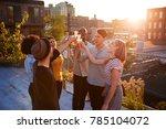 friends make a toast at a... | Shutterstock . vector #785104072