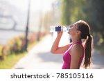 athlete woman drinking water... | Shutterstock . vector #785105116