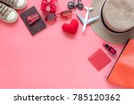 Small photo of Flat lay image of accessory clothing women to plan travel in valentine's day background concept.Essential items for traveler & backpacker adult or teenage to holidays trip.Space for creative design.