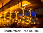 different glasses hanging over... | Shutterstock . vector #785133706
