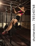 Professional female athlete performing butterfly kipping pull-ups at the gym determination motivation strength power agility strength workout exercising training physical activity concept
