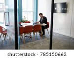 young businessman working alone ... | Shutterstock . vector #785150662