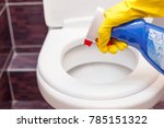 woman in yellow rubber gloves... | Shutterstock . vector #785151322