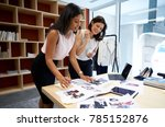 two female creatives discussing ... | Shutterstock . vector #785152876