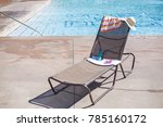 lounge chair by a swimming pool ... | Shutterstock . vector #785160172