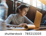 happy smiling girl using laptop ... | Shutterstock . vector #785213335