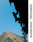 silhouette of a rock climber on ... | Shutterstock . vector #785243602