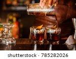 bartender pouring fresh... | Shutterstock . vector #785282026