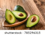 Avocado on old wooden table...
