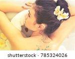 young healthy asian woman lying ... | Shutterstock . vector #785324026