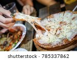 woman's hand take pizza pices... | Shutterstock . vector #785337862