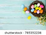 colorful easter eggs in nest... | Shutterstock . vector #785352238