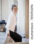 beautiful asian working woman... | Shutterstock . vector #785392696
