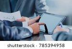 man holding digital tablet | Shutterstock . vector #785394958