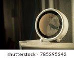 dusty clock on dusty table  | Shutterstock . vector #785395342