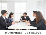 business team on meeting in... | Shutterstock . vector #785401996