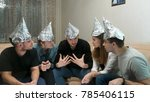 Group Of People With Foil On...