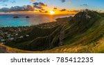 tropical sunrise over Lanikai Beach, Hawaii - from the Kaiwa ridge trail ( pillbox hike ) - see the mokulea islands, rabbit island, and makapuu