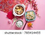 Small photo of Amazing of Vietnamese food for Tet holiday in spring, it is traditional food on lunar new year: pork belly with hard-boiled eggs braised in coconut water, mixed pickles, rice
