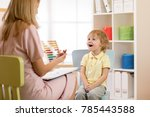 psychologist working with child ... | Shutterstock . vector #785443588