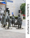 Small photo of WROCLAW - POLAND, JUNE 13, 2017 : The Monument of An Anonymous Passerby, sculpture by Jerzy Kalina. Installation located at the intersection of streets in the city center since 2005