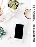 Small photo of office desk flat lay with coffe, smartphone and succulents, clea