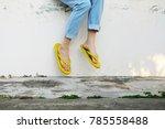 Yellow Sandals. Woman Wearing...