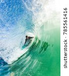 surfer getting tubed in a wave... | Shutterstock . vector #785561416