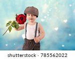 little boy with a red rose ...   Shutterstock . vector #785562022