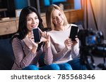 modern devices. cheerful... | Shutterstock . vector #785568346