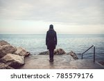 lonely sad woman looking the... | Shutterstock . vector #785579176