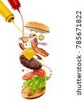 cooking a cheeseburger.... | Shutterstock . vector #785671822