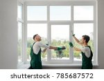 two window installers. positive ... | Shutterstock . vector #785687572