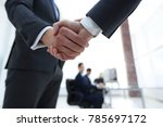 closeup of handshake of... | Shutterstock . vector #785697172