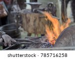 work of  blacksmith at forge ... | Shutterstock . vector #785716258