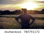 young handsome farmer standing... | Shutterstock . vector #785751172