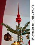 Small photo of Christmas tree with Christmas decoration; Nordmann fir (Abies nordmanniana)