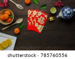 Small photo of shot of accessories Chinese new year & decoration Lunar festival concept background.beautiful arrangement essential items on modern rustic brown wood at home office desk.Accessory for the holiday.
