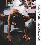 sweating people practicing yoga ...   Shutterstock . vector #785776492