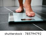 female bare feet with weight... | Shutterstock . vector #785794792