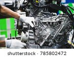 workers are assembling engines... | Shutterstock . vector #785802472