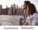 two young couples standing on... | Shutterstock . vector #785816092