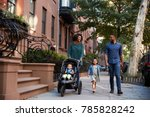 family taking a walk down the... | Shutterstock . vector #785828242