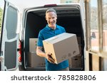 proud delivery man in blue... | Shutterstock . vector #785828806