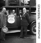 Small photo of Bureau of Prohibition car used by Treasury agents when stopping suspected vehicles. L-R: Prohibition Administrator Ames Woodcock; H.M. Lucious, Secretary of the Automobile Club of Maryland; and Ernest