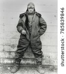 Small photo of Pilot William C. Hopson, U.S. Air Mail Service in winter flying clothing, 1926. He wears an oversize fur-lined outer leather jumpsuit with double button front closure. Underneath is another double bre